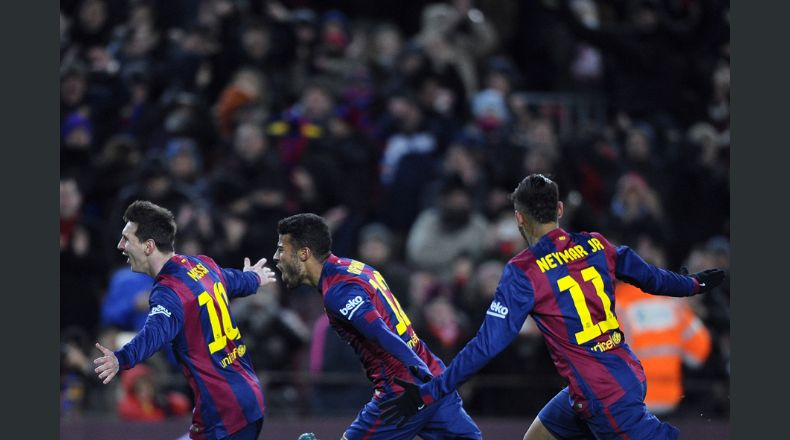 FC Barcelona's Lionel Messi, from Argentina, left, reacts after scoring with his teammates Rafinha, center, and Neymar, from Brazil, right, against Villarreal during a Spanish La Liga soccer match at the Camp Nou stadium in Barcelona, Spain, Sunday, Feb. 1, 2015. (AP Photo/Manu Fernandez)
